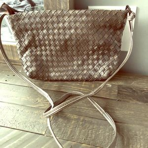 Grey woven leather bag.